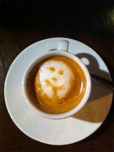 Cara en el café